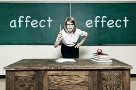 Teacher with 'affect' and 'effect' on blackboard